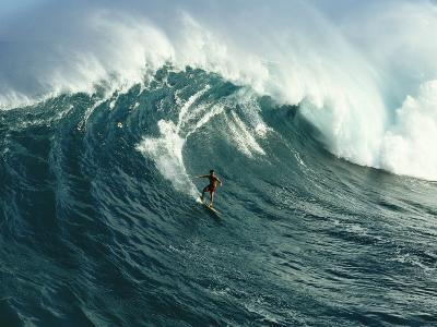 A Surfer Rides a Powerful Wave off the North Shore of Maui Island-Patrick McFeeley-Photographic Print