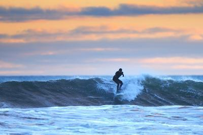 A Surfer Rides a Winter Wave Off the Coast of Maine at Sunset-Robbie George-Photographic Print