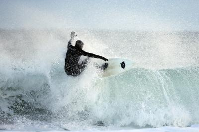 A Surfer Rides a Winter Wave Off the Coast of Maine-Robbie George-Photographic Print