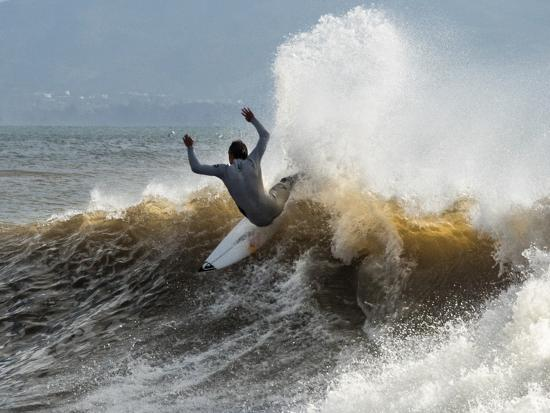 A Surfer Takes The Top Of A Wave In Santa Barbara, Ca-Daniel Kuras-Photographic Print