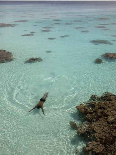 A Swimmer at a Resort on the Fakarava Atoll-Aaron Huey-Photographic Print