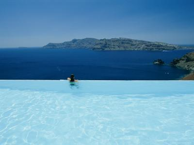 A Swimmer Enjoys the View from a Pool Overlooking the Aegean-Todd Gipstein-Photographic Print