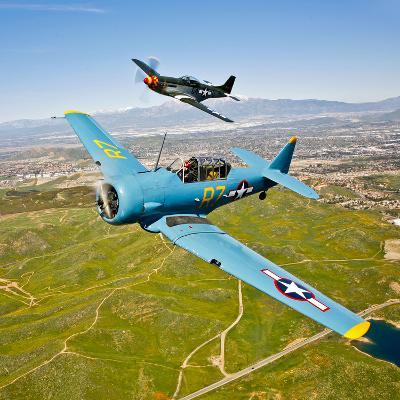 A T-6 Texan and P-51D Mustang in Flight over Chino, California--Photographic Print