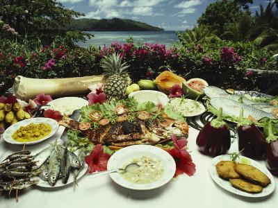 A Table Spread with Fruit and Seafood Prepared in the Local Creole Way-Bill Curtsinger-Photographic Print