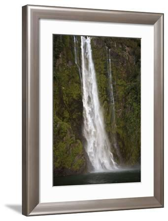 A Tall Waterfall Drops Off a Steep Cliff into Waters, Milford Sound on South Island, New Zealand-Paul Dymond-Framed Photographic Print