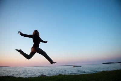 A Teenage Girl Jumps High into the Air-Joel Sartore-Photographic Print