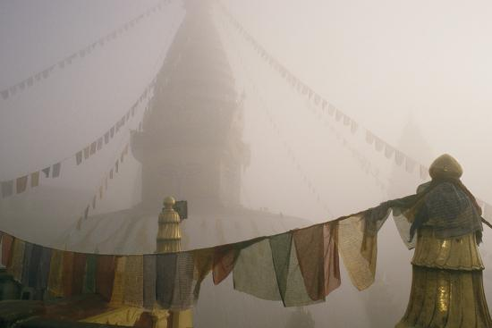 A temple and prayer flags shrouded in fog.-David Edwards-Photographic Print