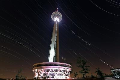 A Three Hour Time-Exposure of Star Trails Above the Milad Communication Tower in Tehran-Babak Tafreshi-Photographic Print