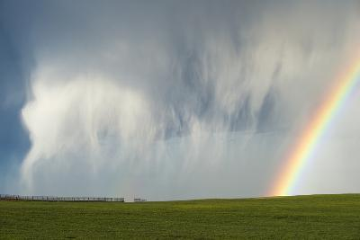 A Thunderstorm Produces a Curtain of Falling Hailstones Next to a Rainbow-Jim Reed-Photographic Print