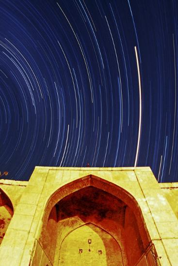A Time-Exposure of Star Trails Above a Historic Caravansary. the Brightest Trail Is Planet Mars-Babak Tafreshi-Photographic Print