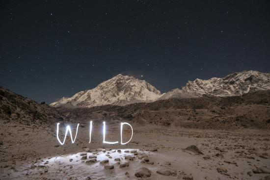 """A Time Exposure of the Word """"Wild"""" Written Beneath the Peak of Mount Everest-Max Lowe-Photographic Print"""