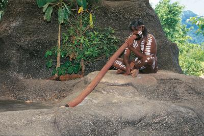 A Tjapukai Aborigine Playing the Didgeridoo--Photographic Print