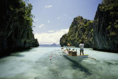 A Tourist Boat Travels Through the Islands of the El Nido Area-Paul Chesley-Photographic Print