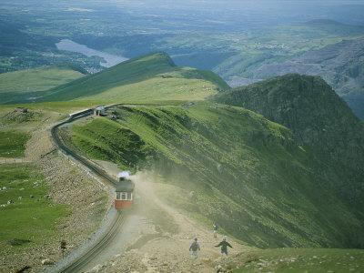 https://imgc.artprintimages.com/img/print/a-train-carrying-tourists-chugs-up-snowdon-mountain-in-wales_u-l-p4ebs50.jpg?p=0