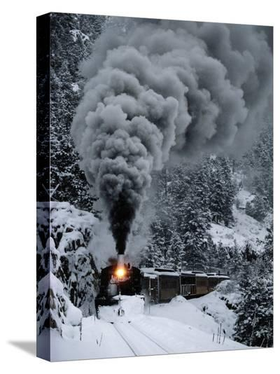 A Train Chugs Through the Snow Blanketing the San Juan Mountains-Paul Chesley-Stretched Canvas Print