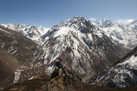 A Trekker Looks Out at the View of Ganesh Himal Mountains in Nepal-Alex Treadway-Photographic Print
