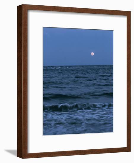 A Twilight Shot of Waves Coming into Shore with the Moon in the Background-Ira Block-Framed Photographic Print