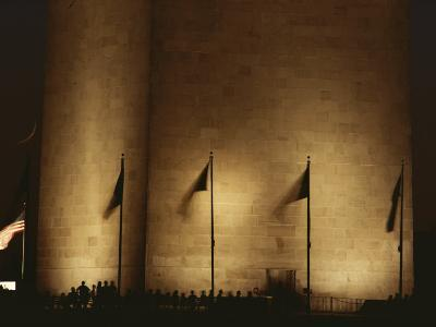 A Twilight View of American Flags Flying at the Washington Monument-Karen Kasmauski-Photographic Print