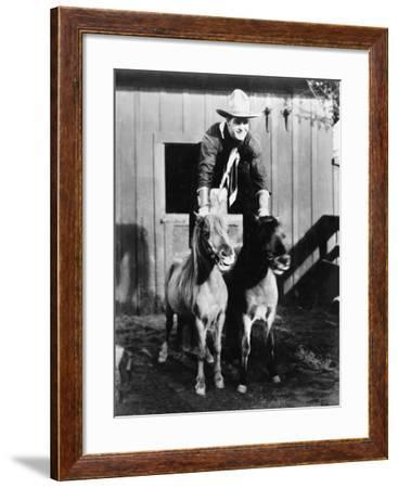 A Two Horse Power Ride, Cowboy Riding Two Ponies--Framed Photo