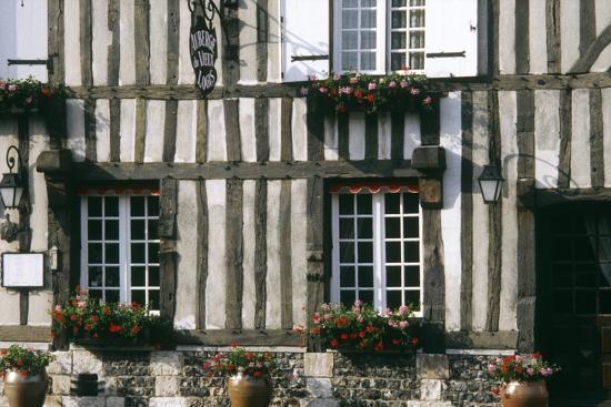 A Typical Traditional Timber Framed Building with Flowers in Window Boxes- LatitudeStock-Photographic Print