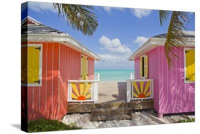 A Typical Tropical Scene with Colorful Buildings, Palms and Water-Mike Theiss-Stretched Canvas Print