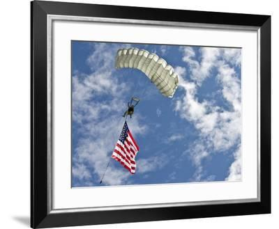 A U.S. Air Force Member Glides Through the Sky with TheAmerican Flag-Stocktrek Images-Framed Photographic Print