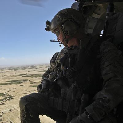 A U.S. Army Special Forces Soldier Looks Out from a Uh-60 Black Hawk--Photographic Print
