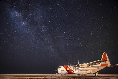 A U.S. Coast Guard C-130 Hercules Parked on the Tarmac on a Starry Night--Photographic Print