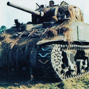 A U.S. Sherman M4 Tank with British Soldiers Near Caen During the Battle Between Allied