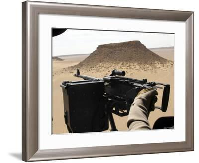 A UH-60 Blackhawk Helicopter Crew Chief Holds an M240G Medium Machine Gun During a Flight-Stocktrek Images-Framed Photographic Print