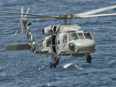 A US Navy SH-60F Seahawk Flying Off the Coast of Pakistan-Stocktrek Images-Photographic Print