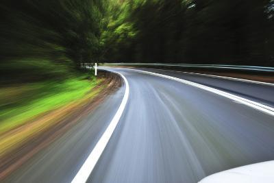 A View of a Bend in the Road from a Moving Vehicle-Keith Ladzinski-Photographic Print