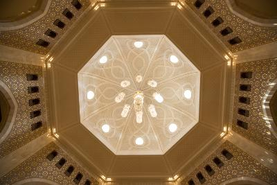 A View of a Chandelier Hanging from a Dome Inside the Sultan Qaboos Grand Mosque-Michael Melford-Photographic Print