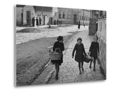 A View of Jewish Children Walking Through the Streets of their Ghetto-William Vandivert-Metal Print