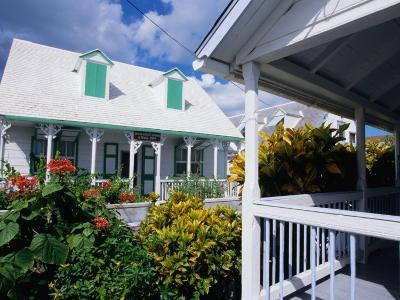 A View of Loyalist Homes and Gardens in Dunmore Town, Dunmore Town, Harbour Island, Bahamas-Greg Johnston-Photographic Print