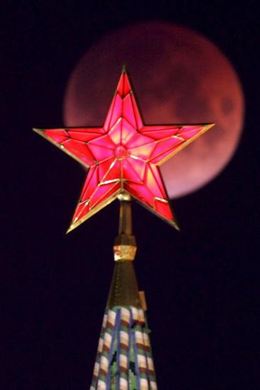 A View of the Lunar Eclipse Above the Kremlin Towers in Moscow-Maxim Shipenkov-Photographic Print