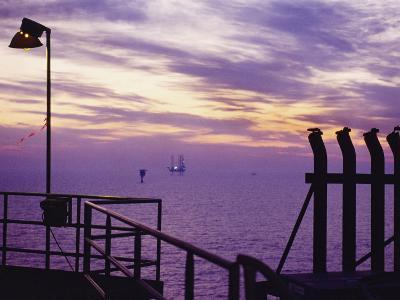 A View Toward Another Platform from an Oil and Gas Drilling Platform--Photographic Print