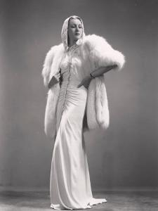 Model Wearing an Evening Gown and a Fur by A. Villani