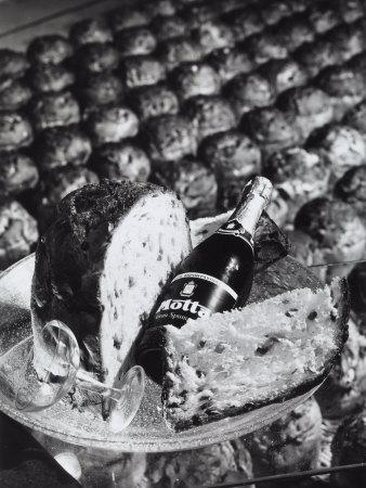 Pannetone, a Bottle of Champagne and a Glass Sitting on a Platter