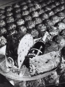 Pannetone, a Bottle of Champagne and a Glass Sitting on a Platter by A. Villani