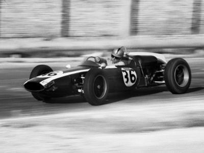 Pilot Driving a Racing Car in a Race