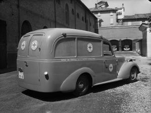 Red Cross Ambulance Parked on a Street in Bologna by A. Villani