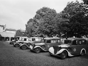 Red Cross Ambulances Parked Inside the Petronio Vecchio Depot, in Bologna, During World War II by A. Villani