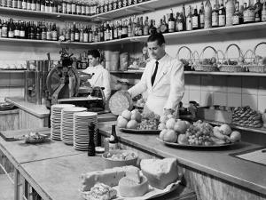 Two Waiters Behind the Counters of the Ristorante Diana, in Via Indipendenza, Bologna by A. Villani