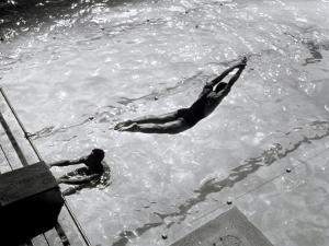 View from Above of a Swimmer Diving by A. Villani