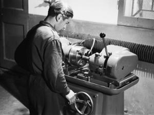 Worker at Work in the S.A.M.P. Mechanical Factory in Bologna, Producer of Precision Mechanisms by A. Villani