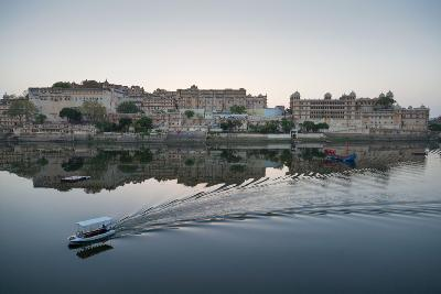 A Water Taxi Passing City Palace Reflected in Still Dawn Waters of Lake Pichola, Rajasthan, India-Martin Child-Photographic Print
