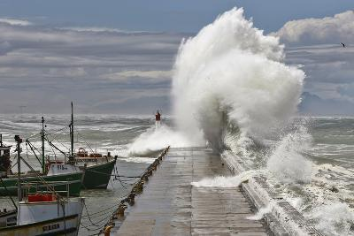 A Wave Breaks over Kalk Bay Harbour Wall in False Bay-Nic Bothma-Photographic Print