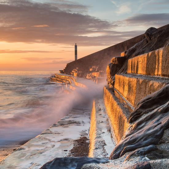 A Wave Rushes towards the Viewer along the Pier Wall at Sunset in Aberystwyth, West Wales, Uk. the-Izzy Standbridge-Photographic Print