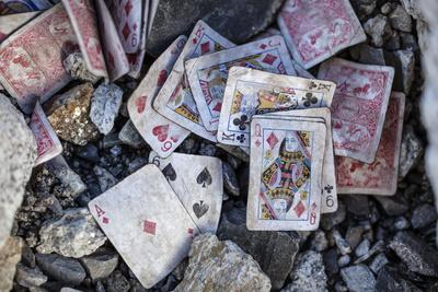 A weathered deck of playing cards at Everest's Base Camp.-Cory Richards-Photographic Print
